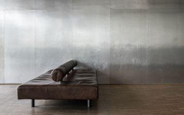 Grey Wall & Brown Sofa