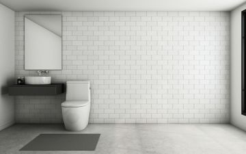 Toilet Against White Brick Wall